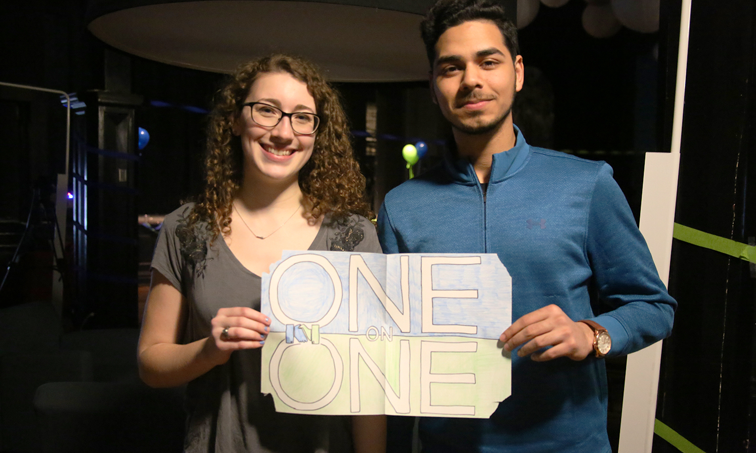 Maddie Conroy 'X and Hamden Ahmed 'X pose for a photo during the International Music Festival hosted by the HWS One-on-One Friendship Club in the Bartlett Theatre.