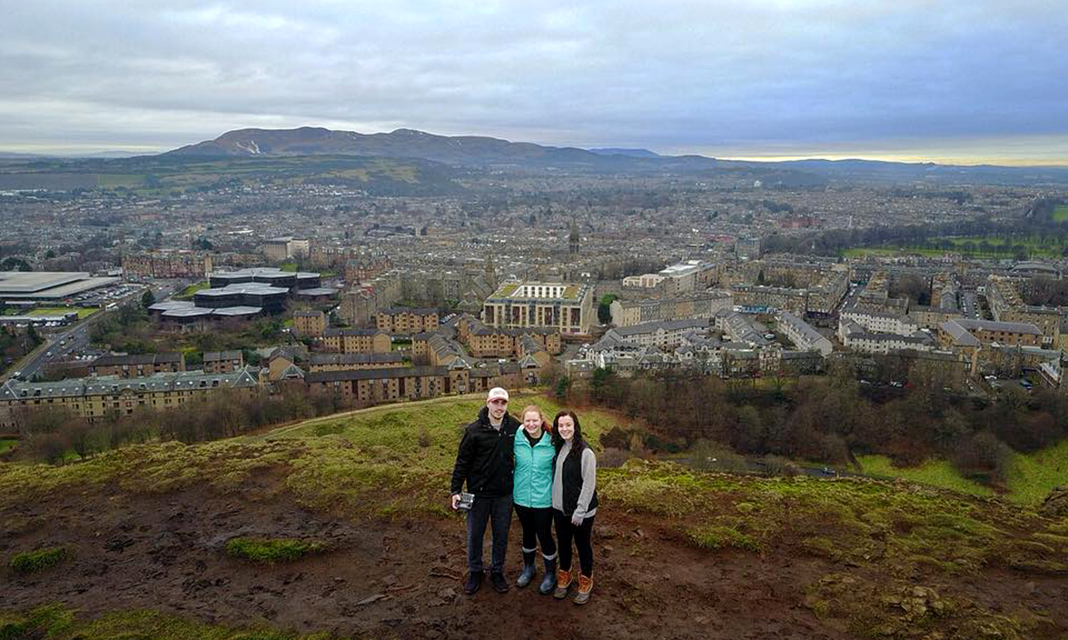 Brett Milligan, Ally Doherty, and Katie Hunt on Arthur's Seat in Edinburgh