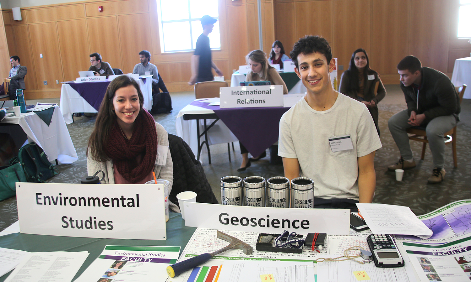 "Katherine Valicenti '19 and Jeremiah Piersante '18 table on behalf of thier respective majors during the ""Get the Inside Scoop"" majors fair and ice cream social for first-years and sophomores in the Vandervort Room."