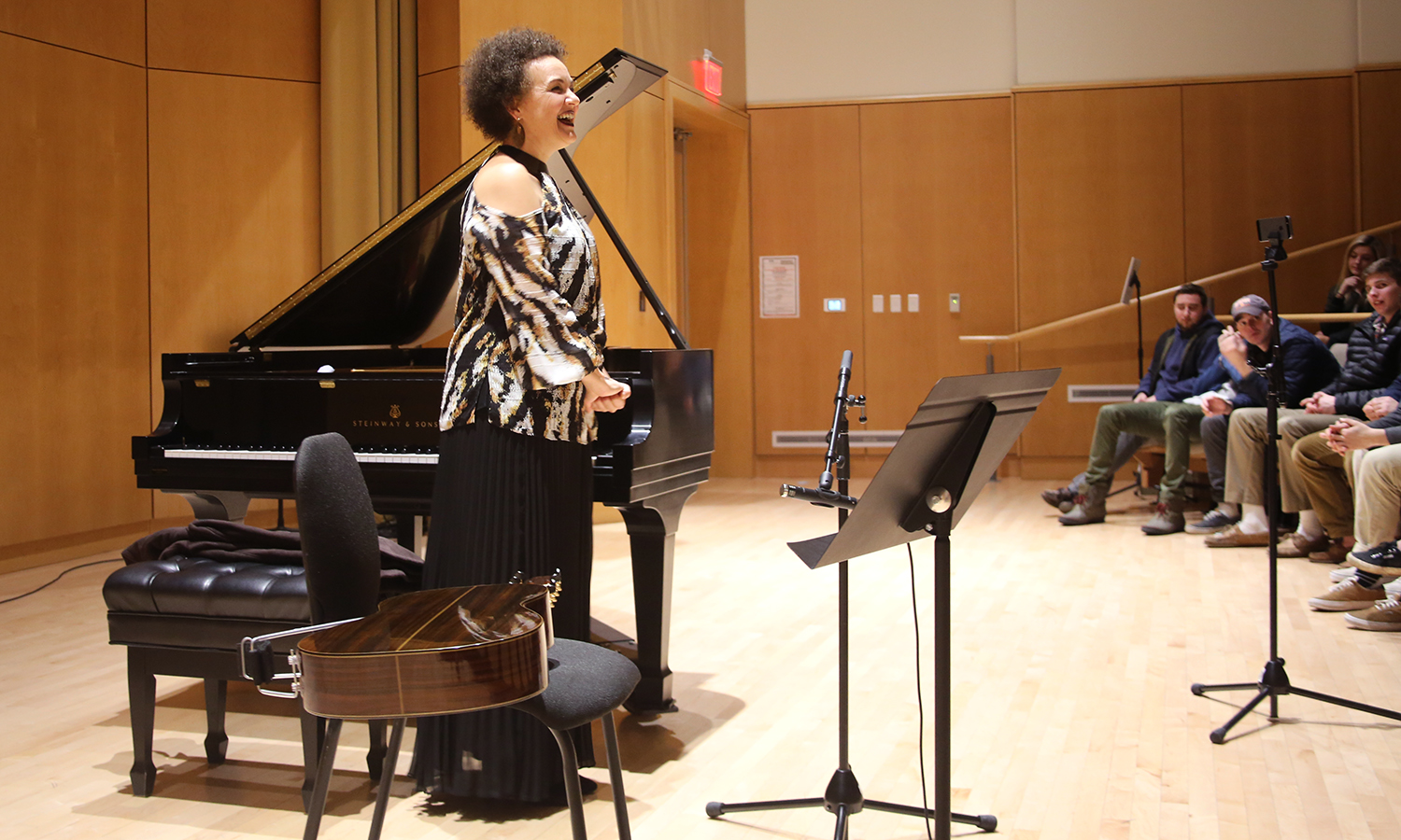 "Catarina Domenici of ""Catarina and James"" receives applause following their performance in Froelich Hall in the Gearan Center for the Performing Arts."