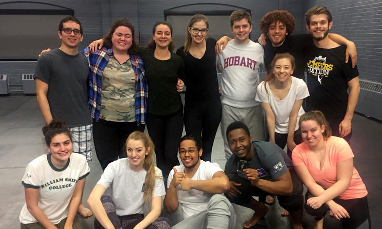"Students in ""Advanced Acting Styles"" with Associate Professor of Theatre Chris Woodworth gather for a photo after welcoming guest artist Katherine Marino '12 (bottom row, left) for a two-day partnering workshop. Marino is a company member of PUSH Physical Theatre."