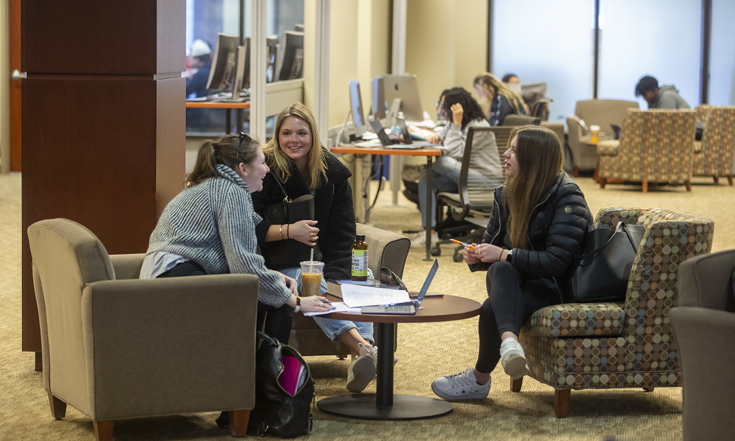 Sasha Goldsmith '22, Joanna Shaw '22 and Karlee Rockstroh '22 study in the Warren Hunting Smith Library.
