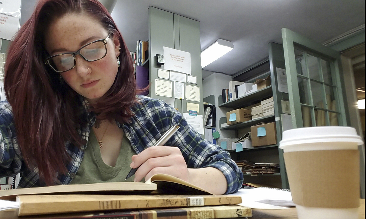 Chloe Sudduth'17 works on research for her honors thesis at the Geneva Historical Society.