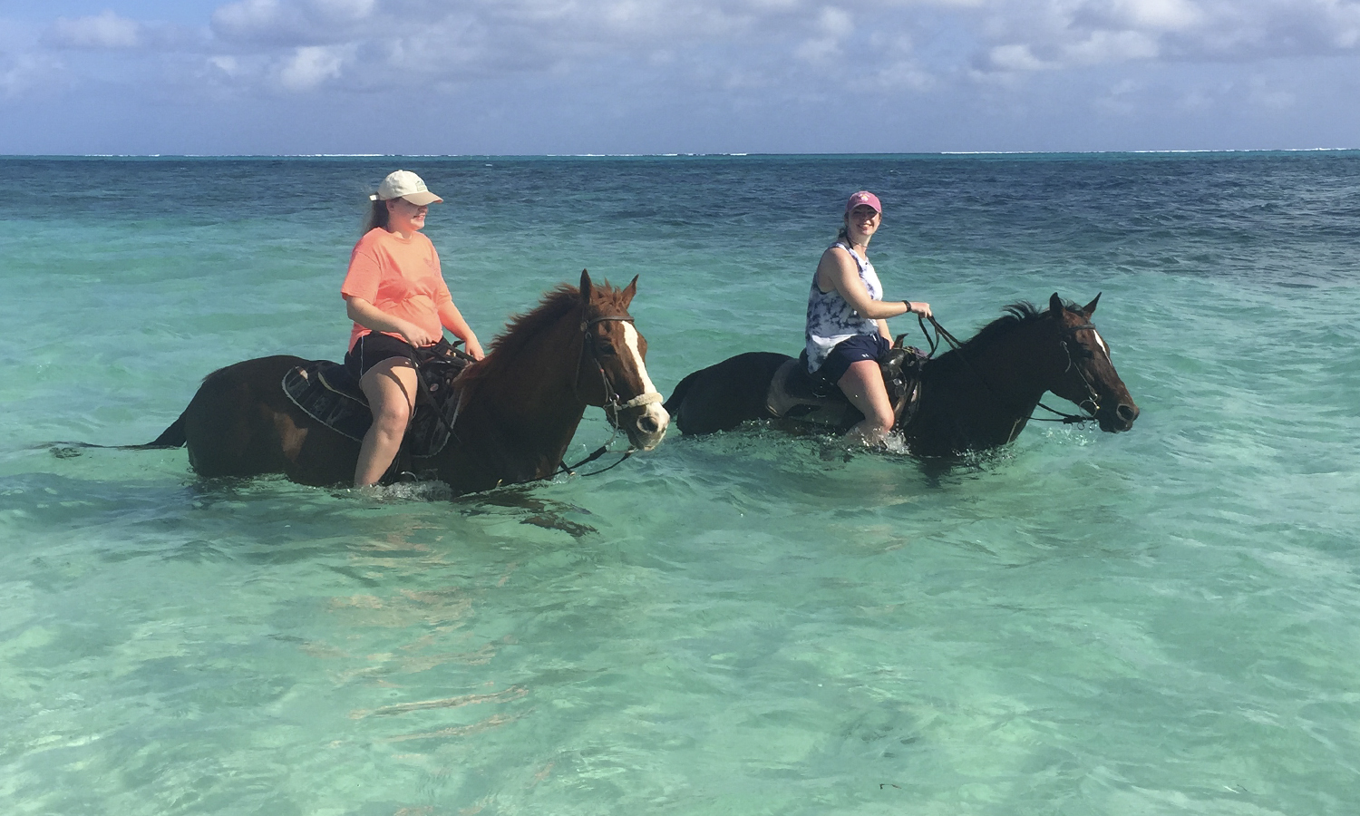 Members of the HWS Equestrian Team Sara Dolan '18 and Meghan Greco '18 ride horses in the Atlantic Ocean while on vacation in Turks and Caicos.