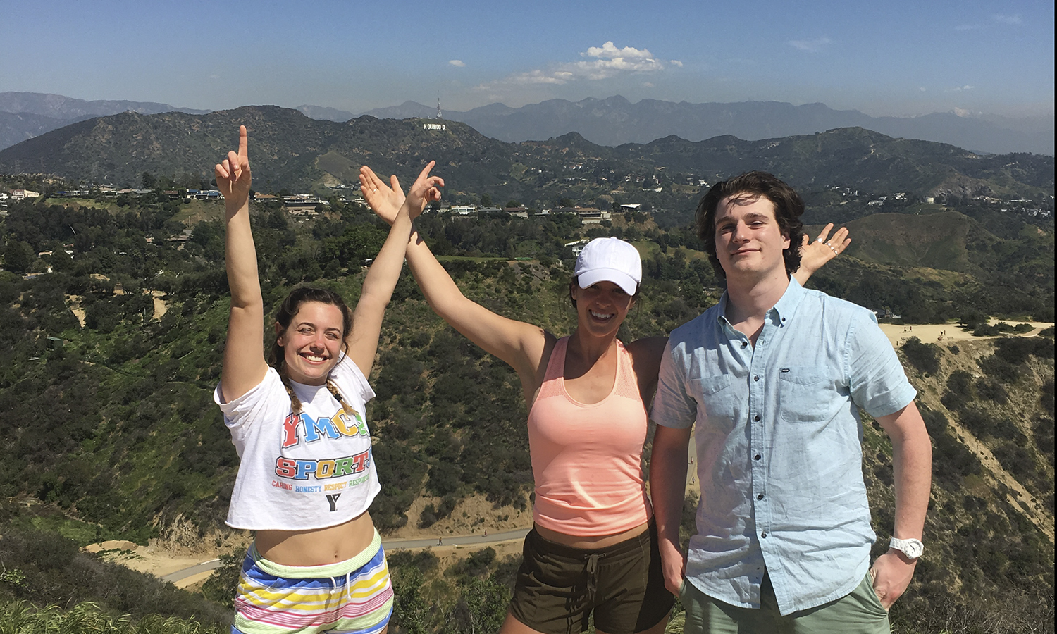 Gaby Milano '19, Cassidy DiPaola '19 and Sandro Carboni  '19 post for a photo after climbing Runyon Canyon in Hollywood, California!