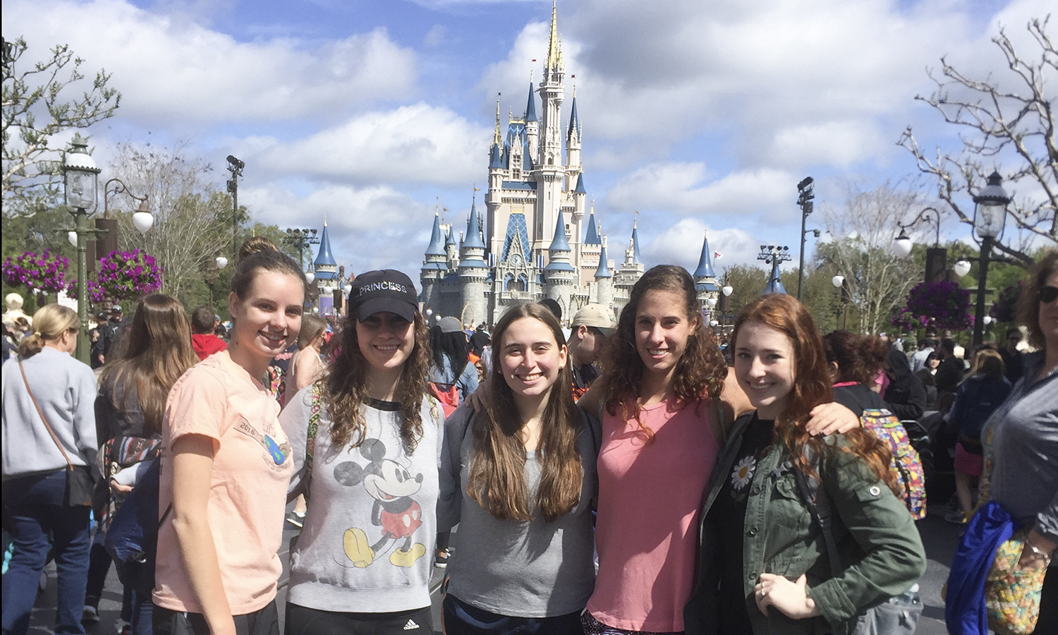 Lauren Mercier 'X(left), Taylor Mancini 'X, Mackenzie Tamblin 'X, Madisen Francis 'X and Mara Sindoni 'X gather for a group photo outside Magic Kingdom in Disney World.