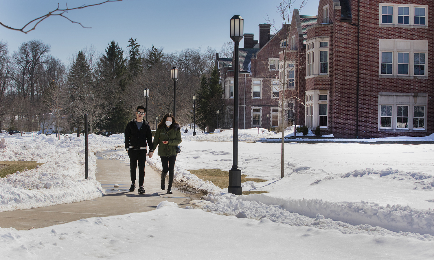 Junwei Cai '19 walks with her friend Yiming Yu on the way to scandling Friday.