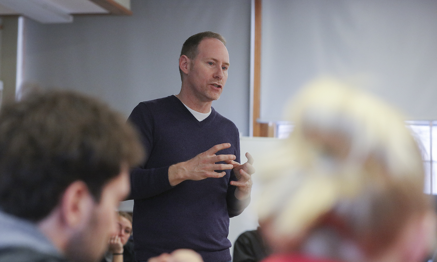 "Director of Teen Empowerment Doug Ackley '90, a non-profit to support positive youth development for inner-city Rochester teens, speaks to students in ""Developmental Psychopathology"" with Visiting Assistant Professor of Psychology Jack Peltz."