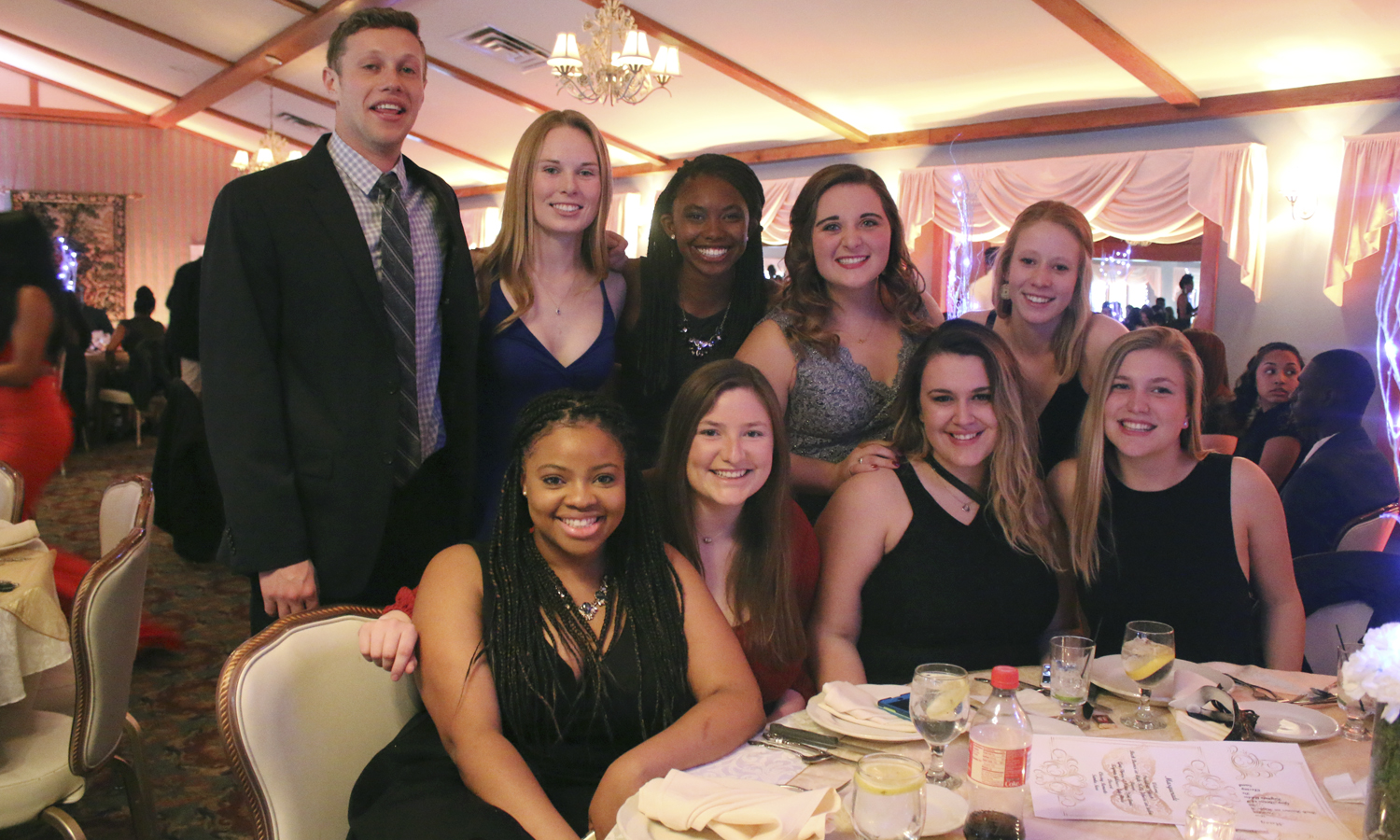 Students gather for a group photo during the Caribbean Student Association's annual Masquerade Ball at the Belhurst Castle.