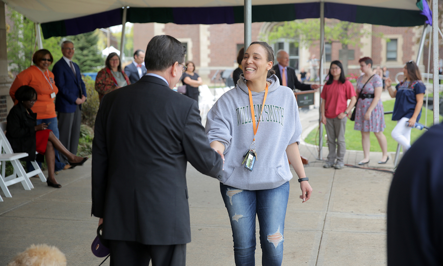 Gabbie Grimmett '17 shakes hands with President Mark D. Gearan during rehearsal for Commencement on the Quad.
