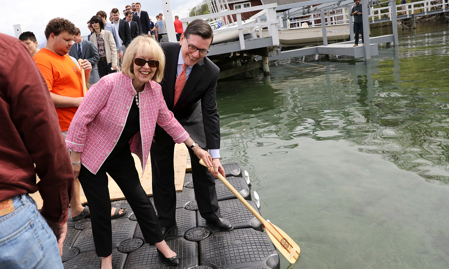 As honorary members of the Hobart College Class of 2017, Mark D. Gearan and Mary Herlihy Gearan dip their oar in Seneca Lake.