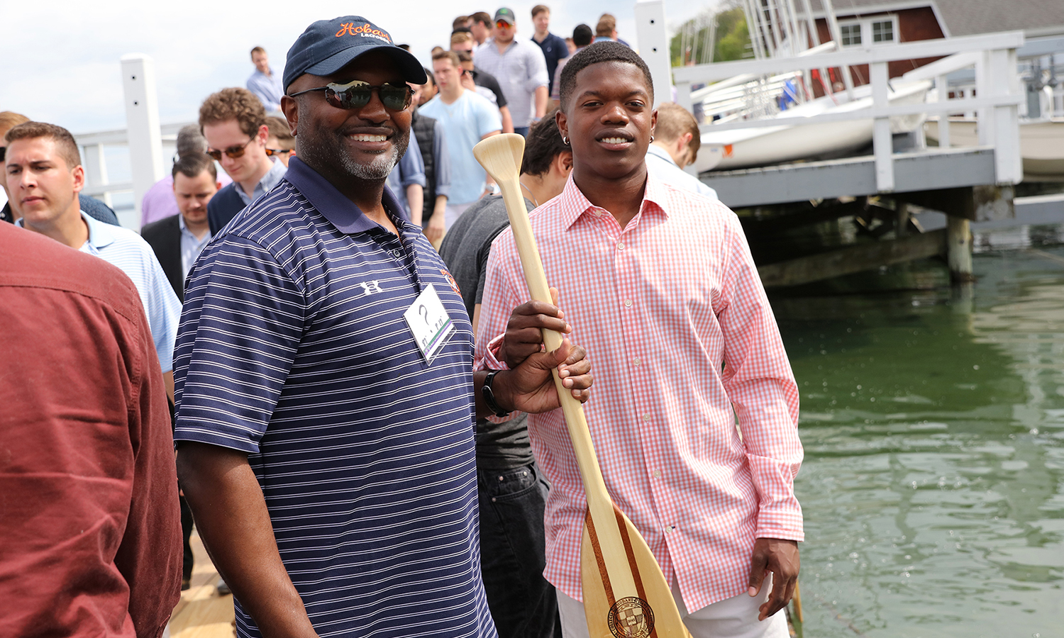 "Mark ""Skip"" Darden '87, P'17 presents his son Mark Darden '17 with a class paddle during the Hobart Launch."
