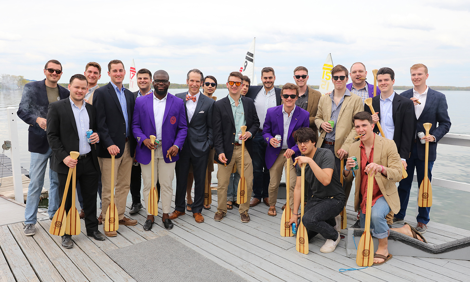 Assistant Vice President for Advancement and Alumni Relations Jared Weeden '91 joins graduating members of the Sigma Chi Fraternity for a group photo on the docks of Bozzuto Boathouse.