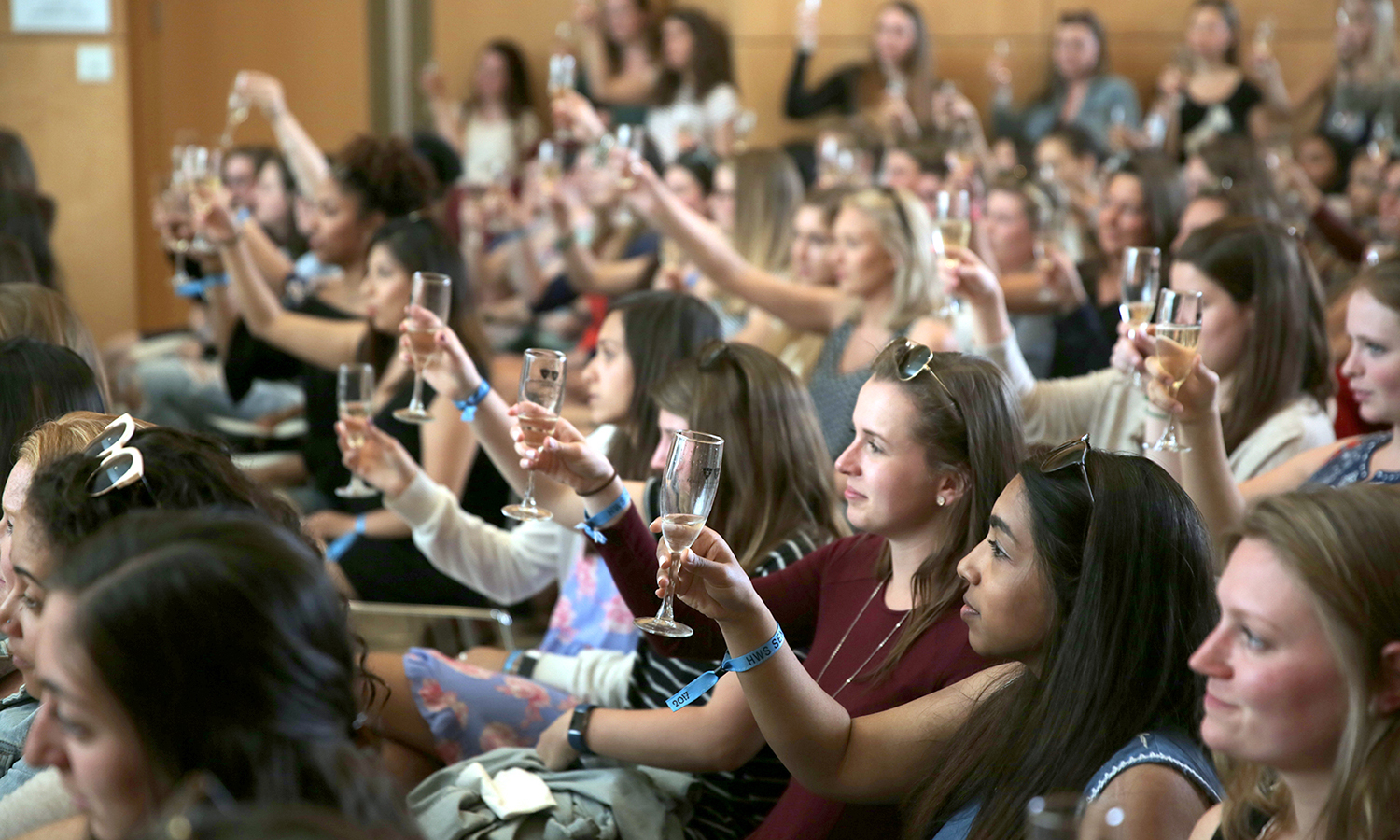 William Smith seniors raise their glasses for a toast during the William Smith Senior Welcome toast in the Gearan Center for the Performing Arts.