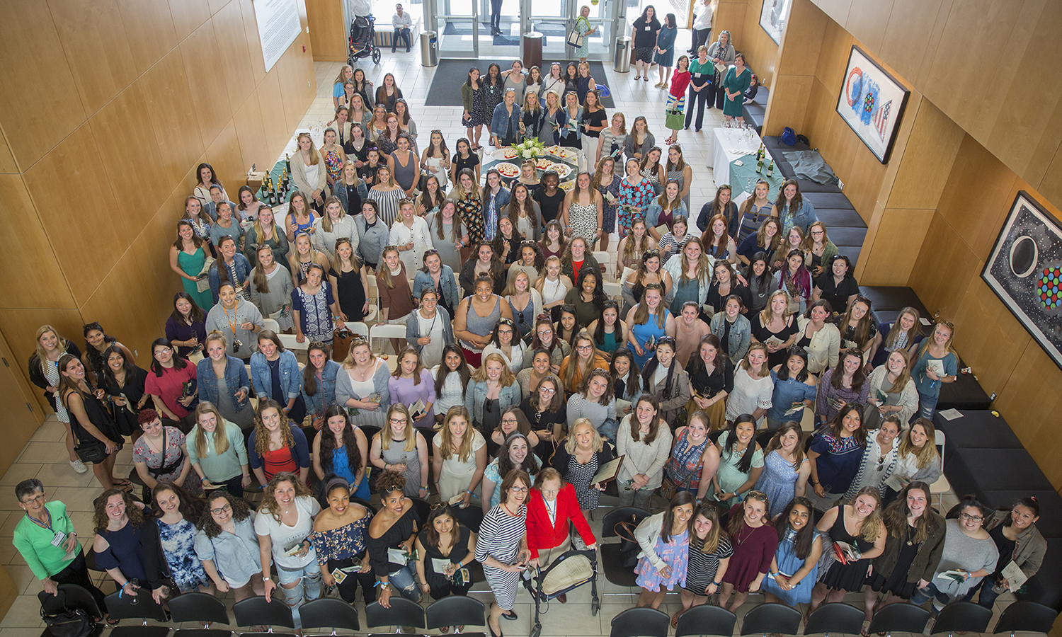 Members of The William Smith Class of 2017 pose for a photo in the lobby of the Gearan Center for the Performing Arts during the annual Senior Welcome Toast.