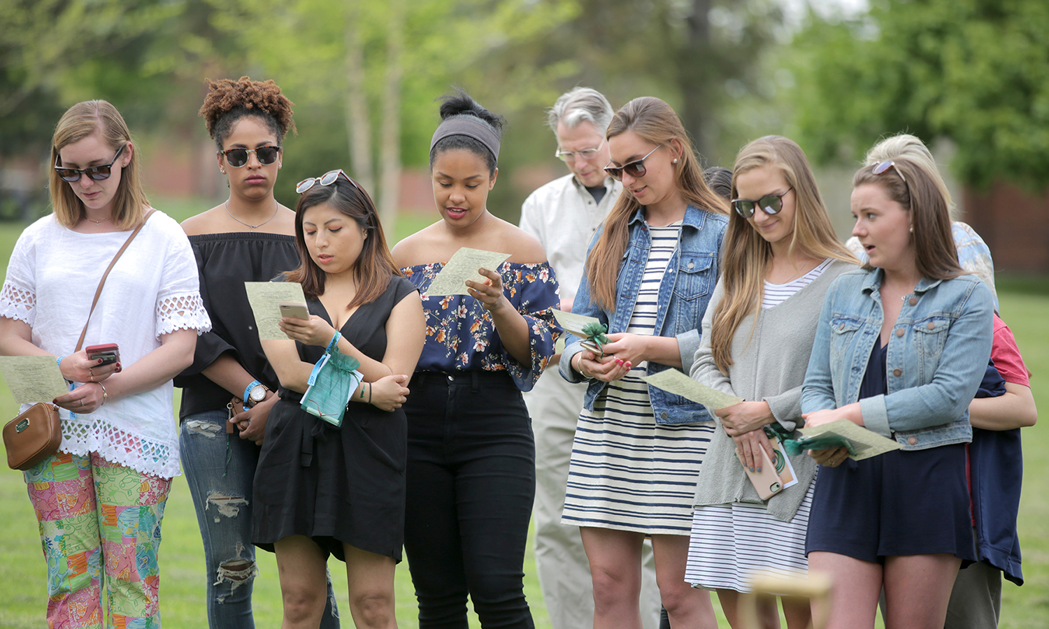 Seniors sing the William Smith alma mater during the traditional tree planting on William Smith Hill.