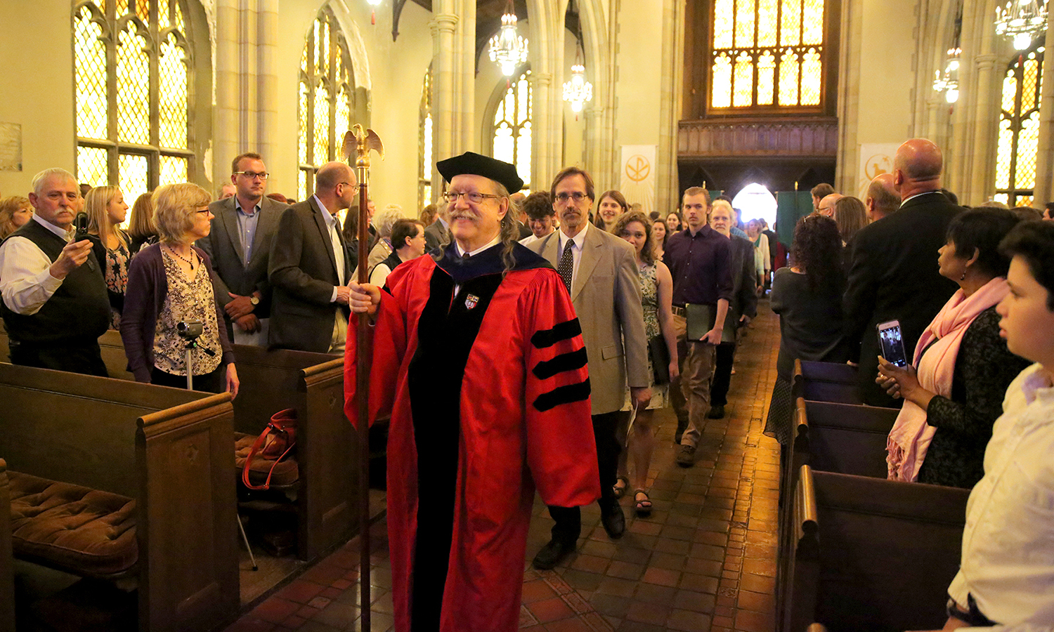 Associate Professor of Asian Studies James-Henry Holland leads the procession of HWS faculty members during Baccalaureate 2017.