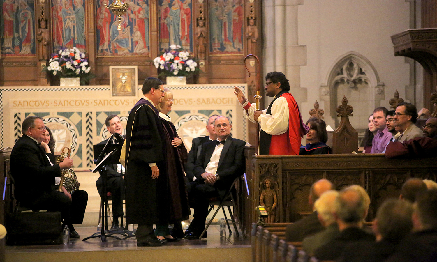 The Rt. Rev. Prince G. Singh, Bishop of the Episcopal Diocese of Rochester and HWS Trustee, blesses Mark D. Gearan and Mary Herlihy Gearan during the 2017 Baccalaureate celebration in Trinity Church.