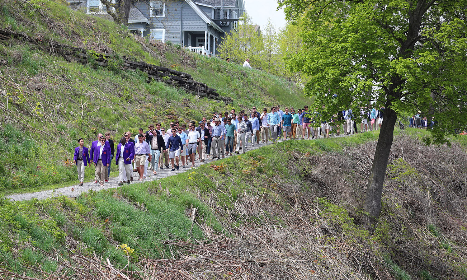 Members of the Druid Honor Society lead the Hobart College Class of 2017 process down the hill to Bozzuto Boathouse for the Hobart Launch.