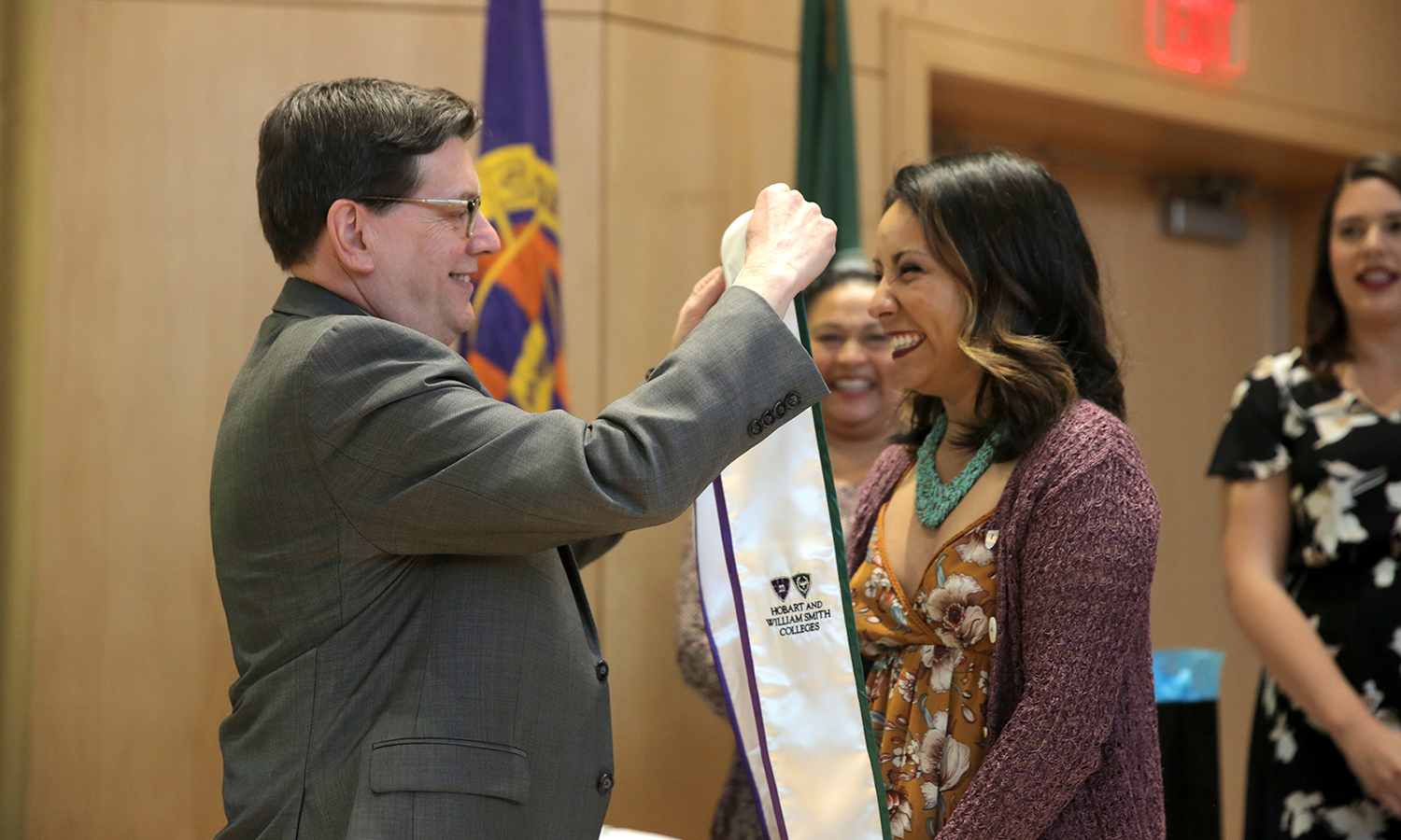 President Mark D. Gearan presents Kimberly Gutierrez '17 with the Posse stole during the Posse Recognition Ceremony in Froelich Hall of the Gearan Center for the Performing Arts.