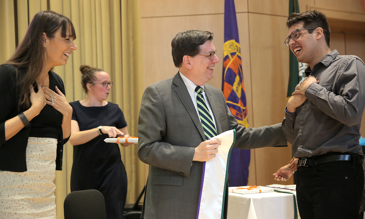 Bryan Quezada '17 accepts his Posse stole from President Mark D. Gearan and Deborah Bial during the Posse Recognition Ceremony.