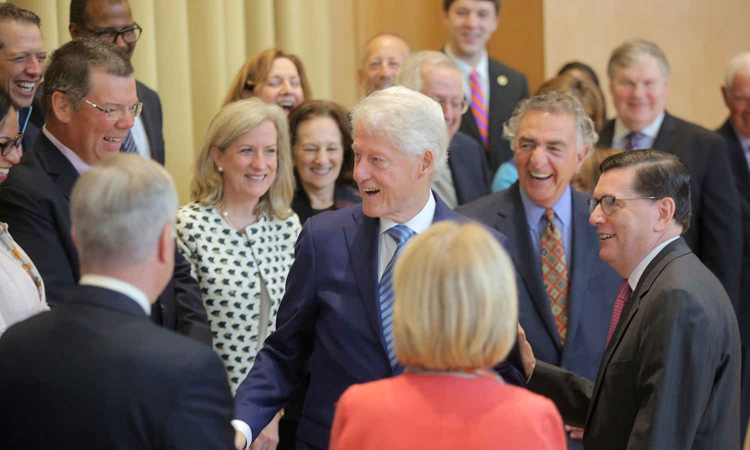 President Bill Clinton greets members of the HWS Board of Trustees in Froelich Hall of the Gearan Center for the Performing Arts before Sunday's Commencement ceremony.