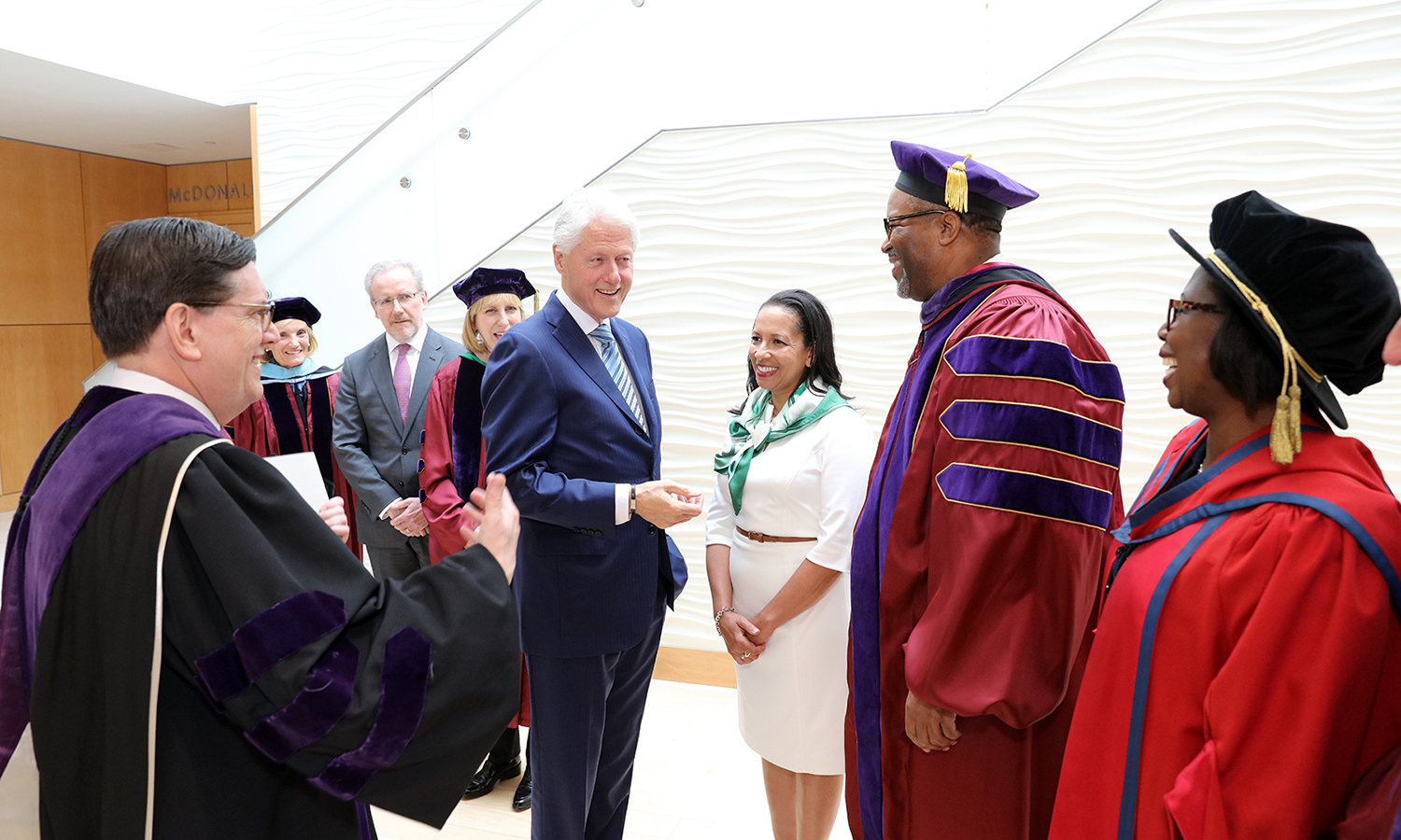 President Bill Clinton chats with HWS President-elect Gregory J. Vincent '83 and his wife, Kim Vincent, before Sunday's Commencement Ceremony.