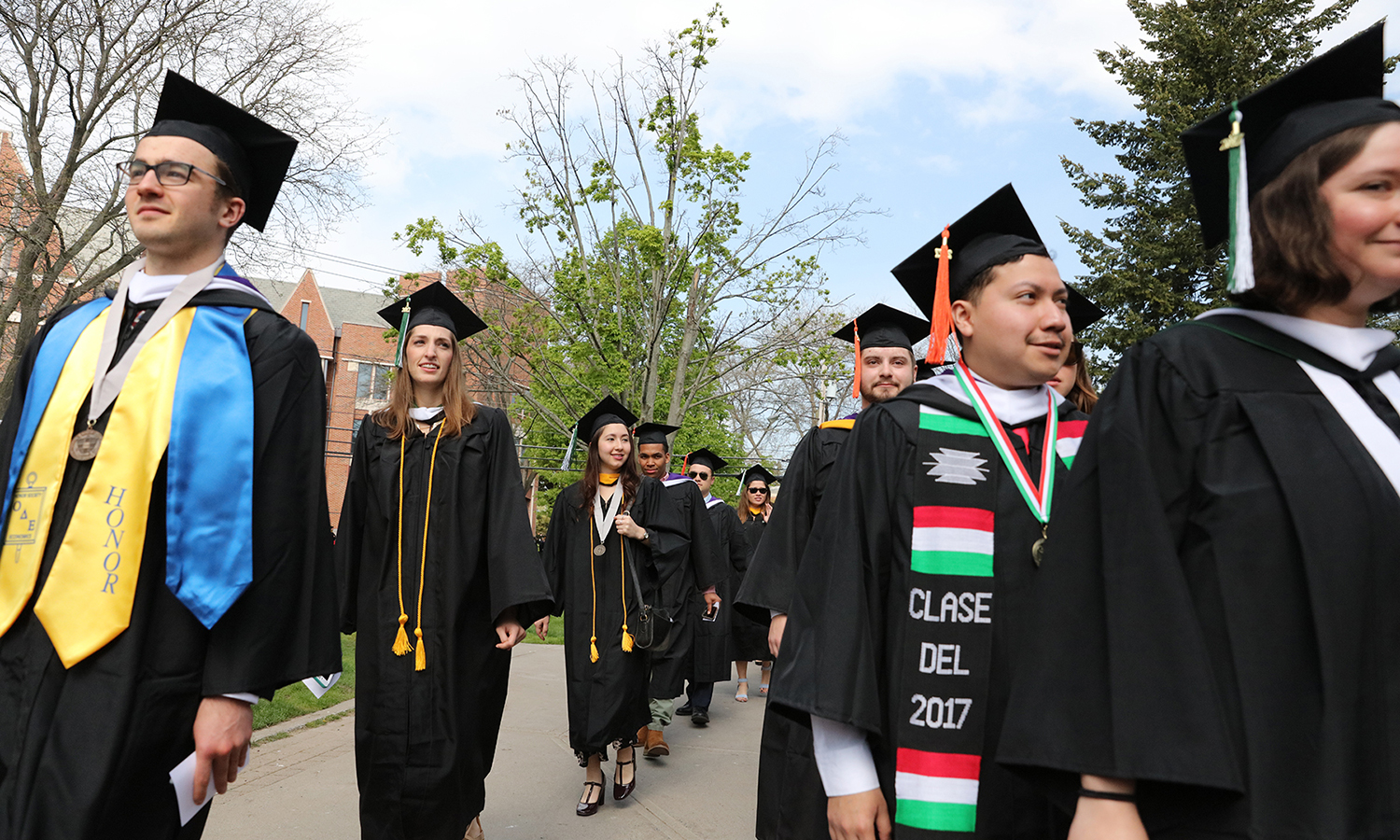The HWS Classes of 2017 walk to the Quad for this year's Commencement ceremony.