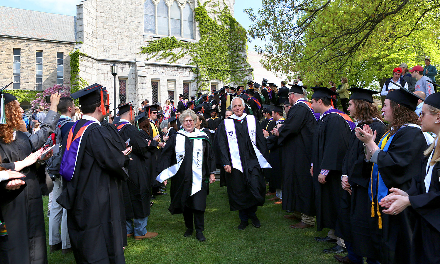 Mara O'Laughlin '66 and Eric Lax '66, L.H.D. '93 lead the 2017 Commencement procession.