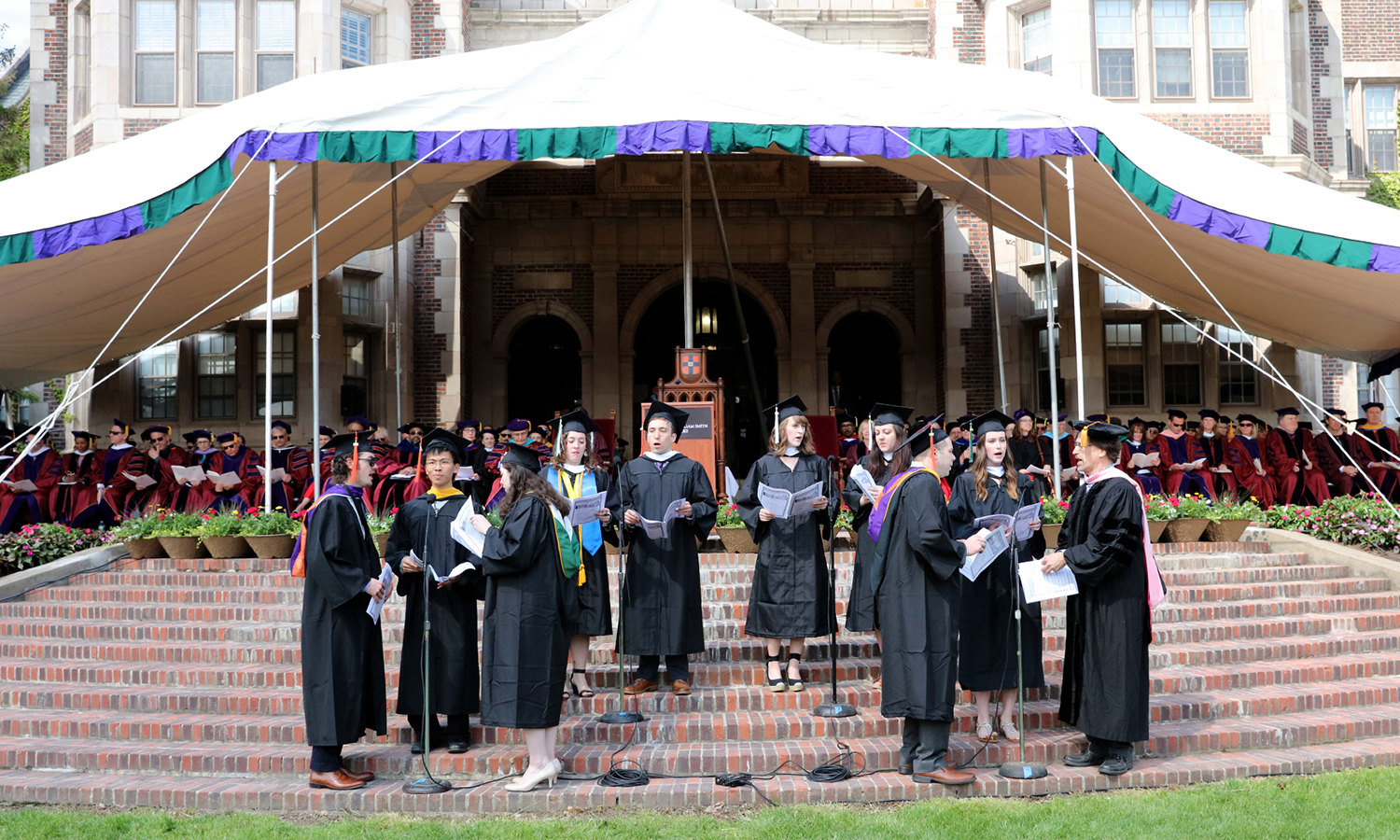 Senior members of the Colleges' Choir perform on the steps of Coxe Hall during Sunday's Commencement ceremony.