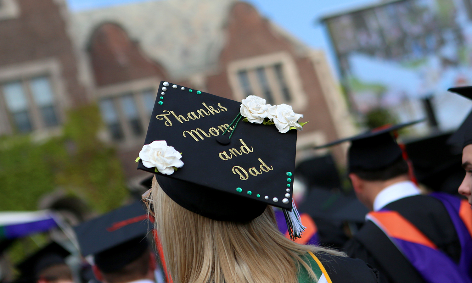 Wearing a decorated cap, Lauren Carr '17 listens during Commencement 2017.