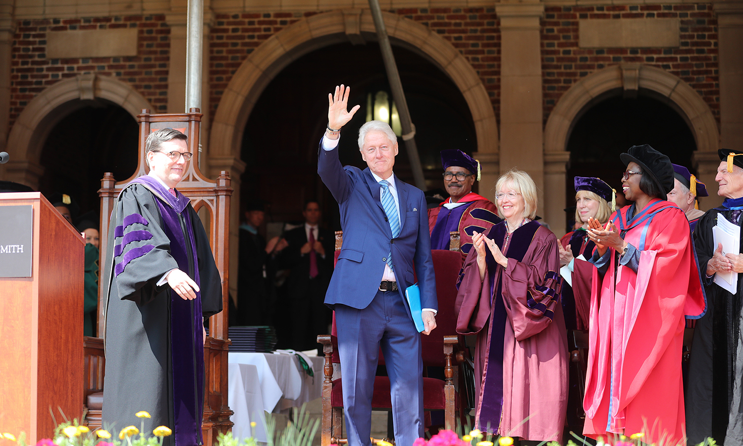President Bill Clinton waves to the audience during Sunday's Commencement ceremony.