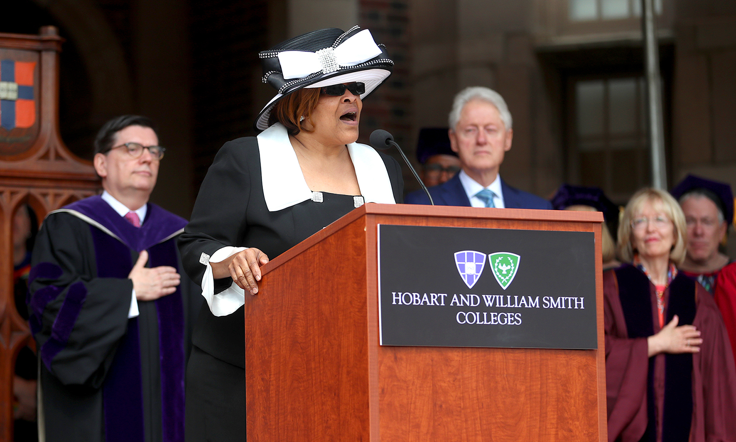 Director of the HWS Gospel Choir Patty Blue '77 sings the national anthem during Commencement 2017.