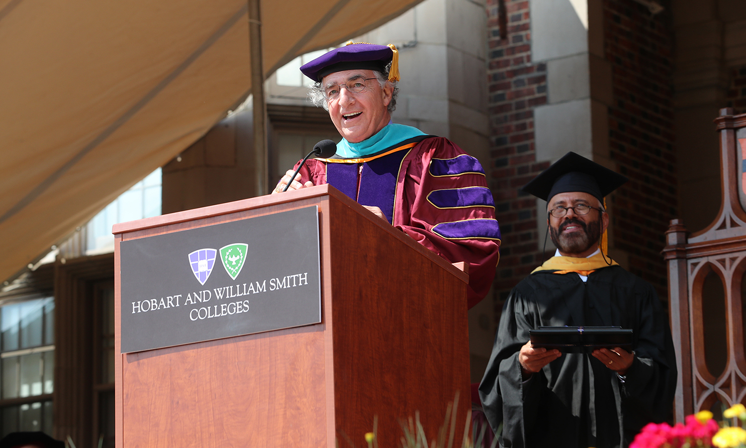 Board Chair Thomas S. Bozzuto '68 confers the title of President Emeritus to Mark D. Gearan during Commencement 2017.