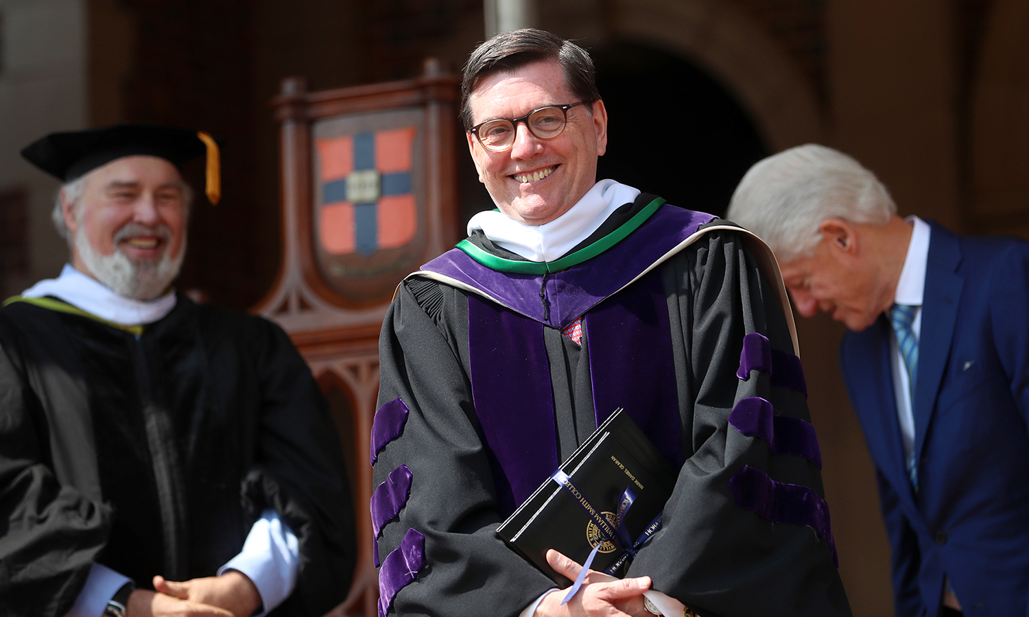 President Mark D. Gearan poses for a photo after being named the first president emeritus in the history of Hobart and William Smith Colleges.