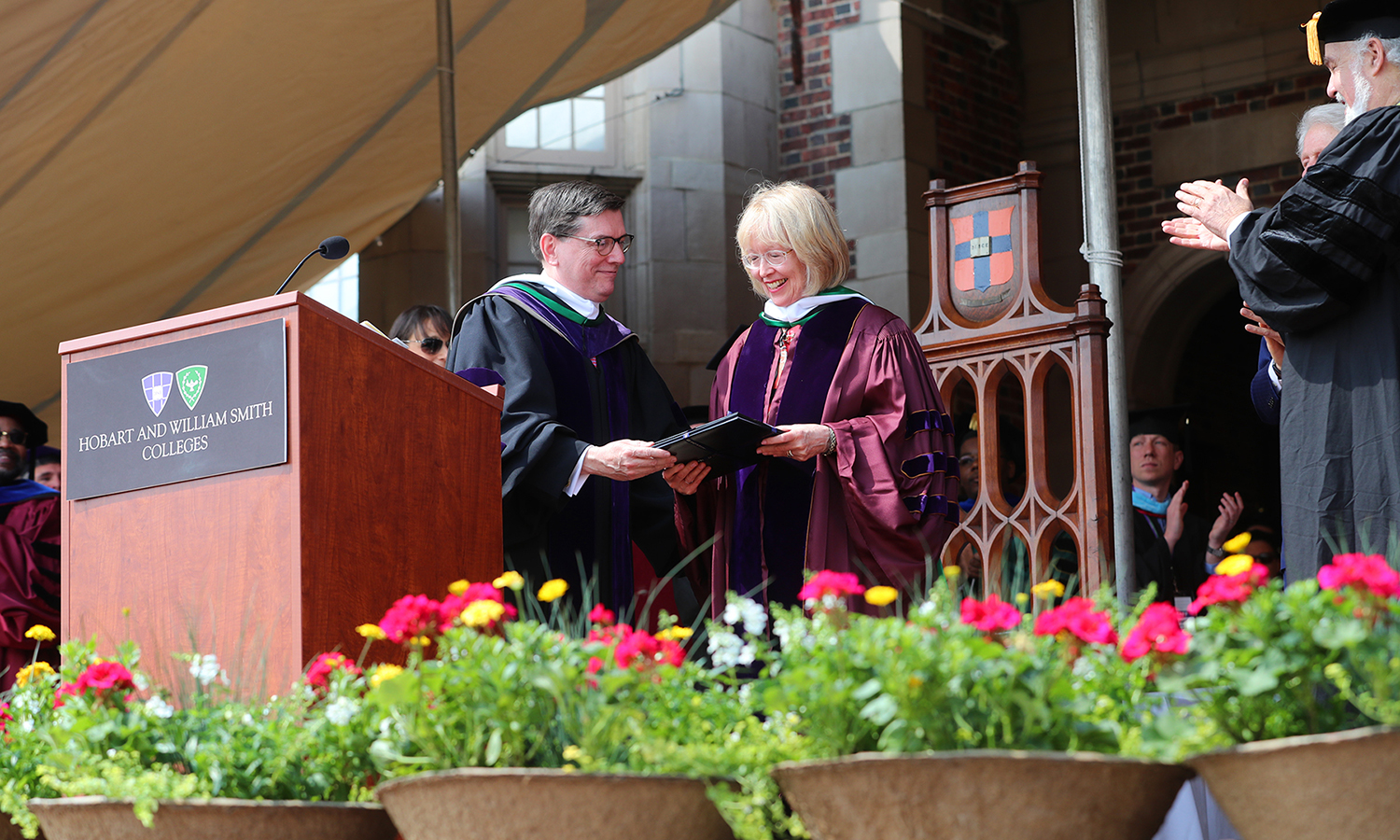 A leader with numerous local and regional organizations touching a variety of issues, including healthcare, diversity, education and poverty, Mary Herlihy Gearan accepts her honorary degree from her husband, Mark D. Gearan, during this year's Commencent ceremony on Sunday.