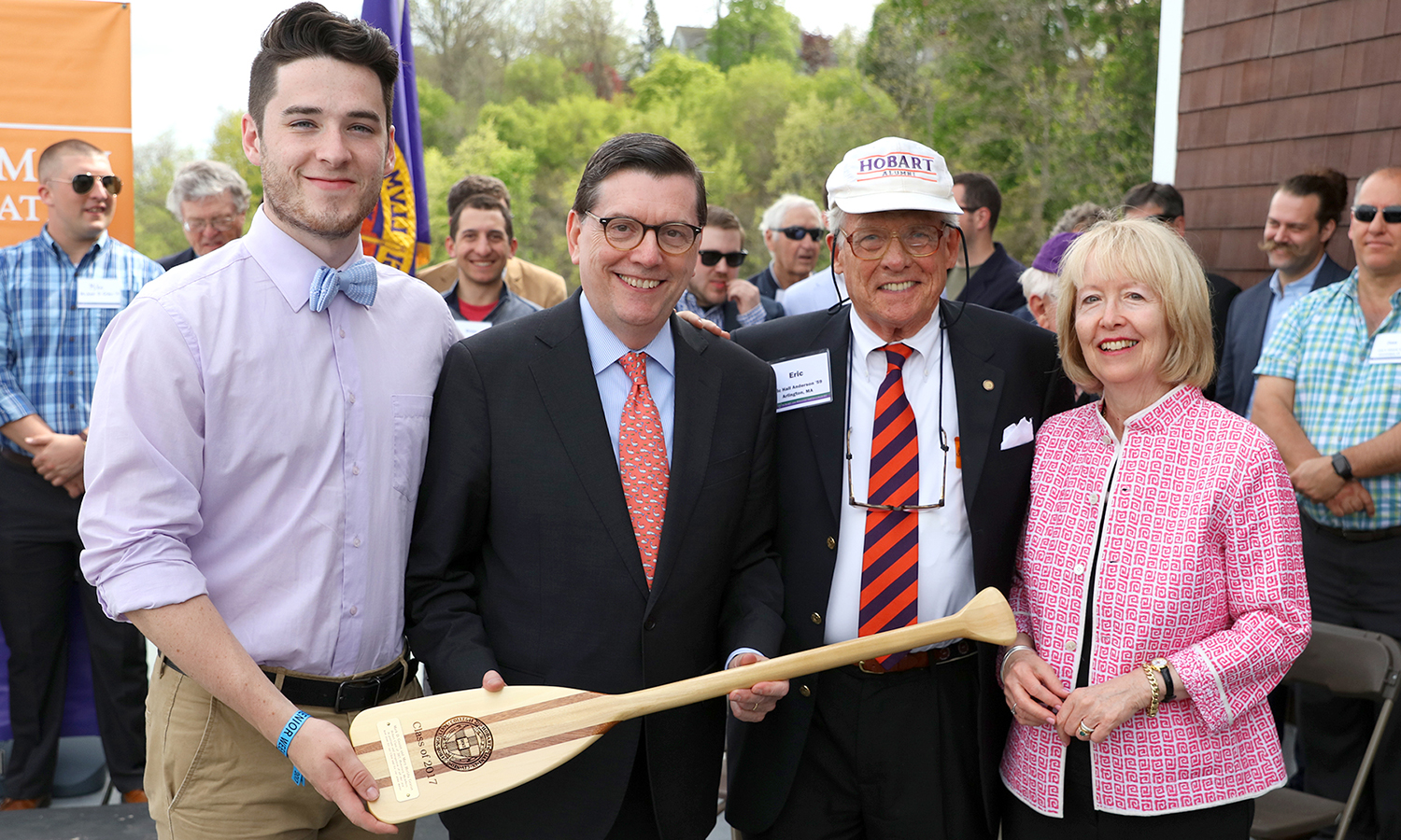 James Mandart '17 (left) and Eric Hall Anderson '59 (right center) welcome Mark D. Gearan and Mary Herlihy Gearan into the Hobart College Class of 2017 with the presentation of a class paddle.