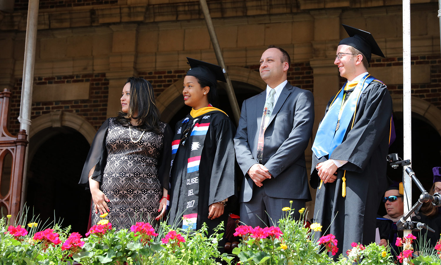 Anggela Sanchez, a bilingual studies teacher at the School of Leadership Development in Bronx, N.Y, and Carlos Mendez, a music teacher and coordinator of music for Fayetteville-Manlius School District in Central New York, receive the Touching the Future Award during Commencement 2017. They were nominated by Jerlin Garo '17 and Chris Demas '17.