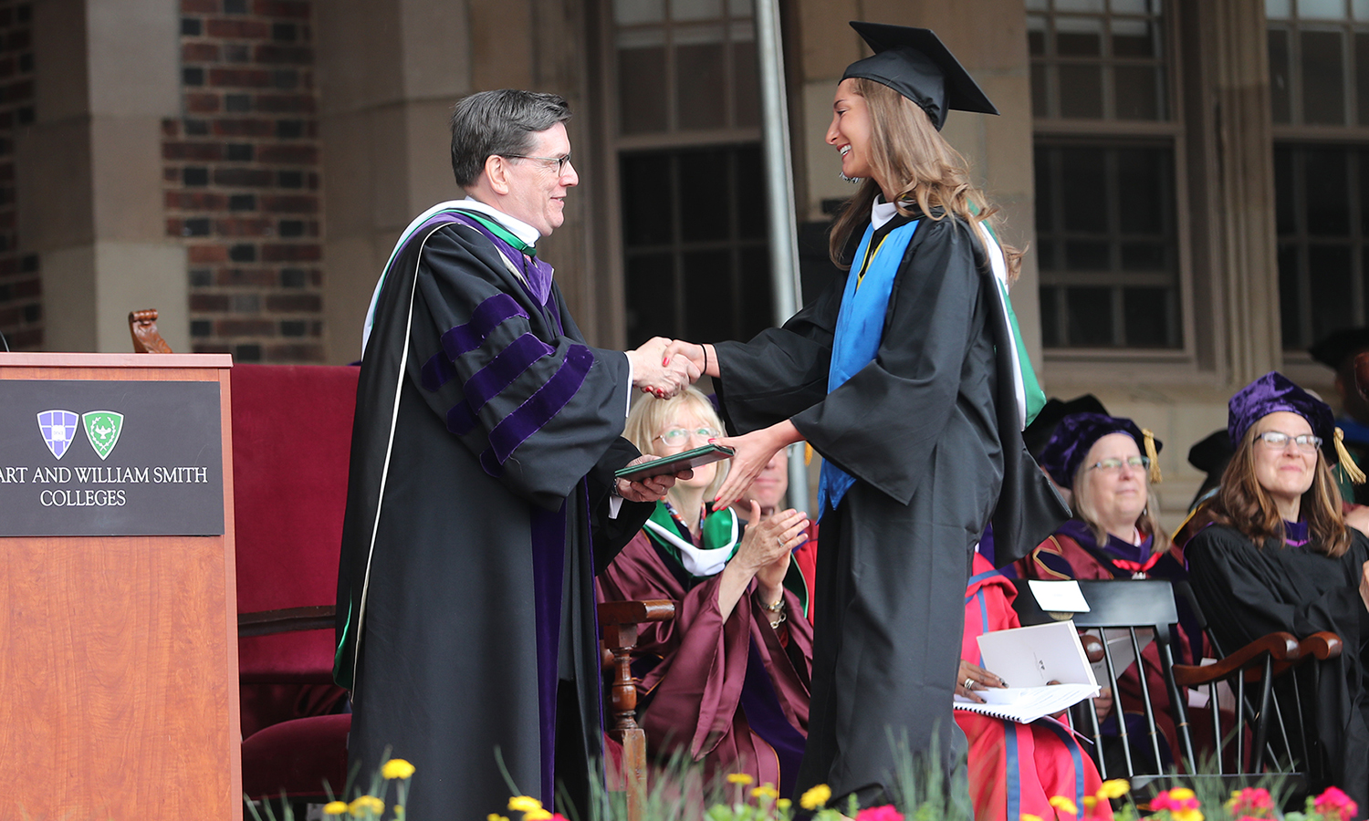 President Mark D. Gearan presents Kelly Mauch '17 with her diploma during Commencement.