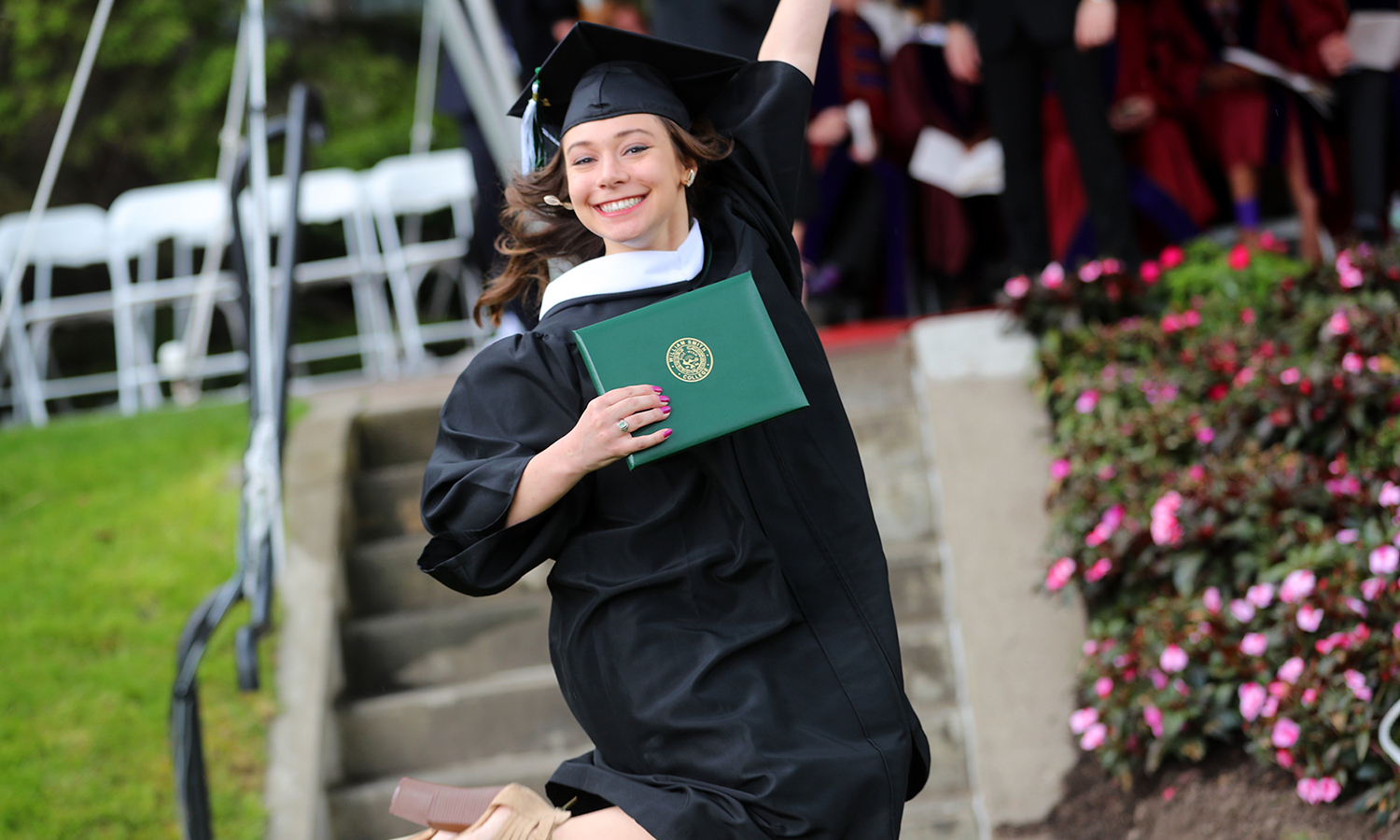 Tanina Urbanski '17 celebrates after receiving her diploma  during Commencement.