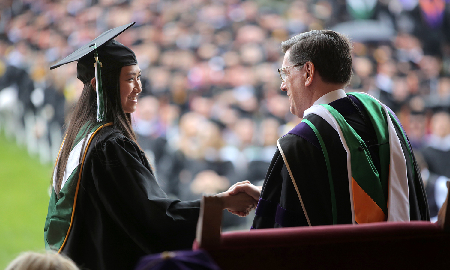 Elizabeth Herbst '17 shakes hands with President Mark D. Gearan during Commencement.