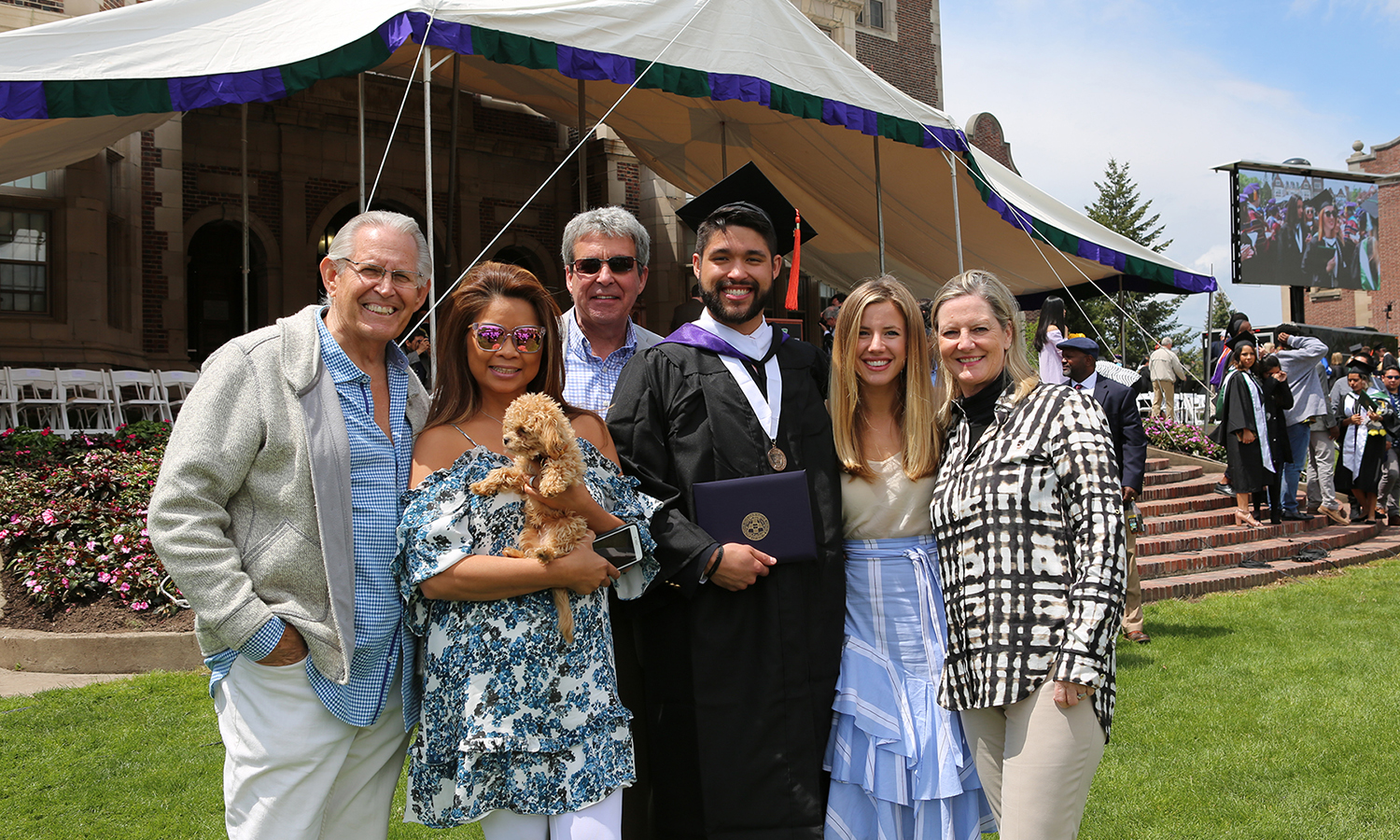 Grant Soucy '17 and his family gather for a photo on the Quad after Commencement on Sunday.