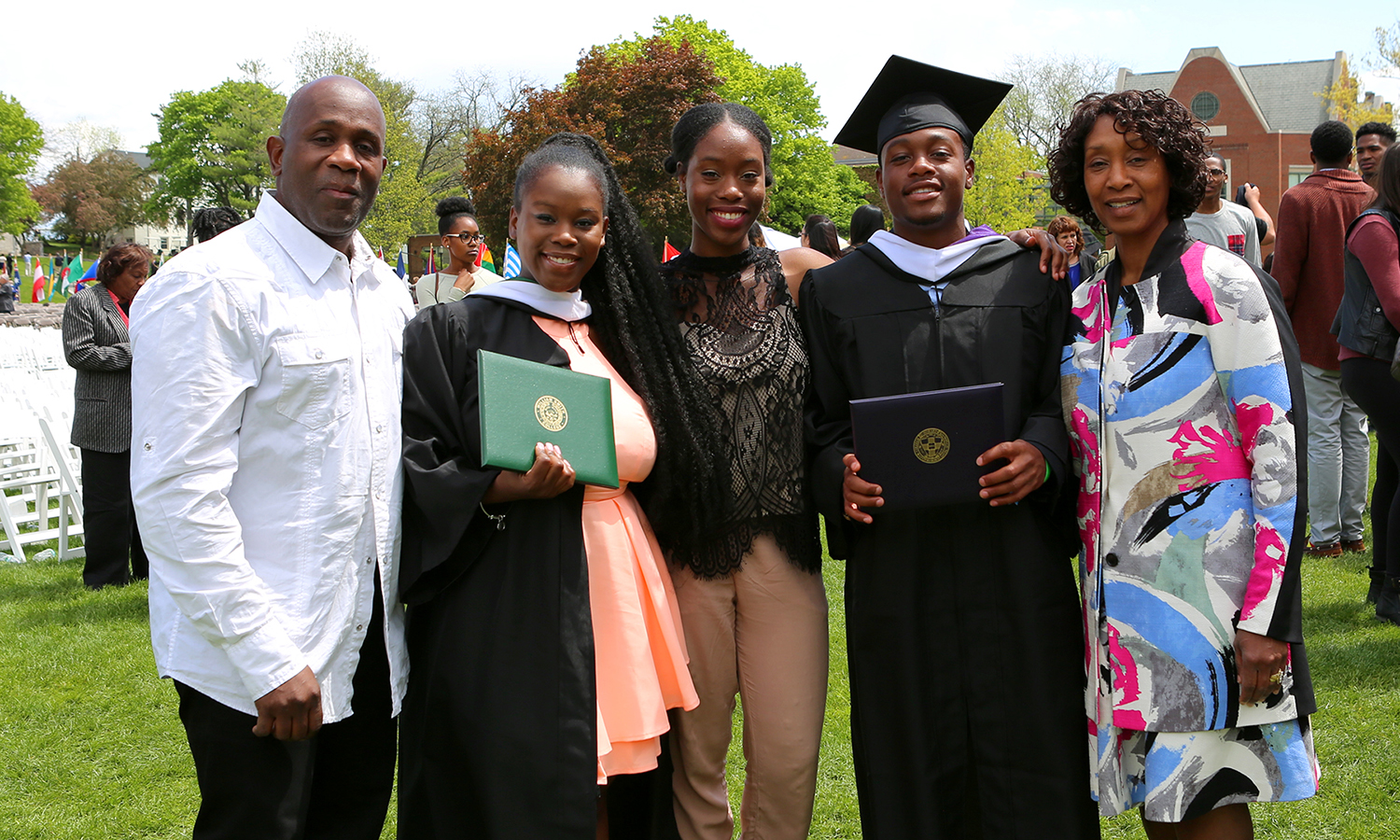 Amber Williams '17 (second from left) and Kenan Williams '17 (second from right) gather for a family photo on the Quad.