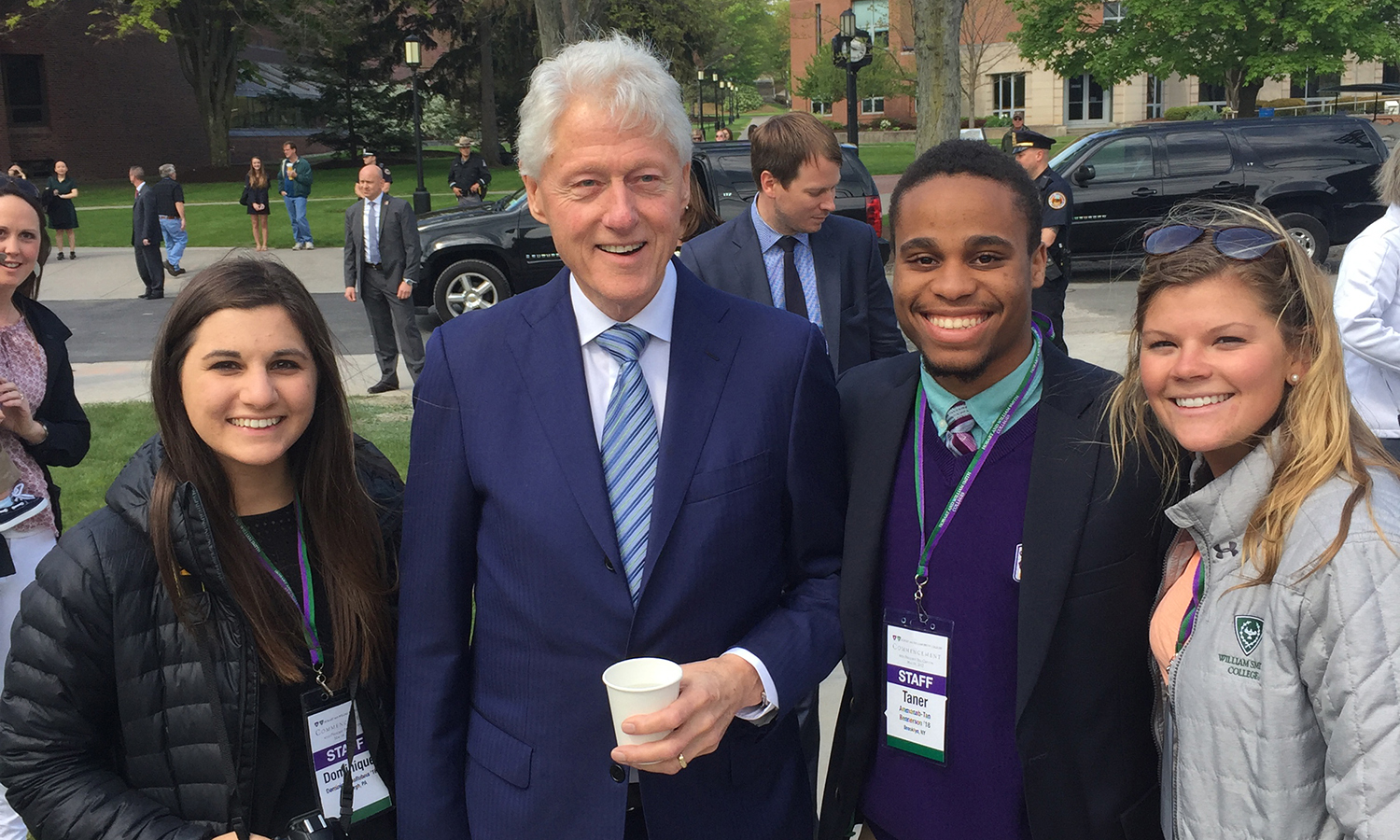 Dominique DeReubis '18, Ammenab-Taner Bennerson '18 and  Annie O'Brien '18 pose for a photo with President Bill Clinton before Commencement on Sunday.