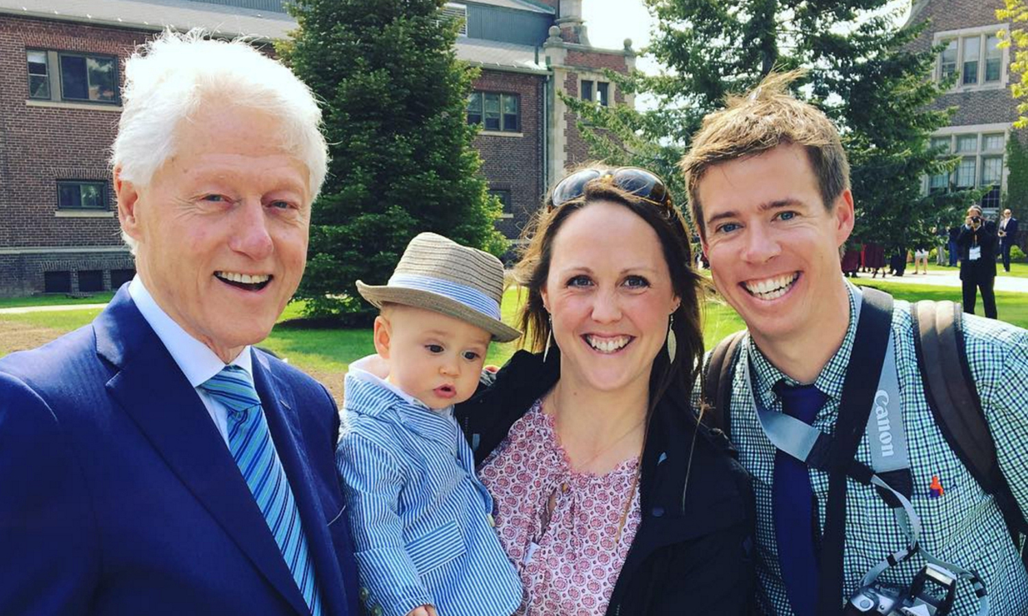 Ben Riskie, son of Hobart Tennis Head Coach Tim Riskie (right) and William Smith Field Hockey Assistant Coach Sophie Riskie '07, makes an appearance for a photo with President Bill Clinton on Sunday.