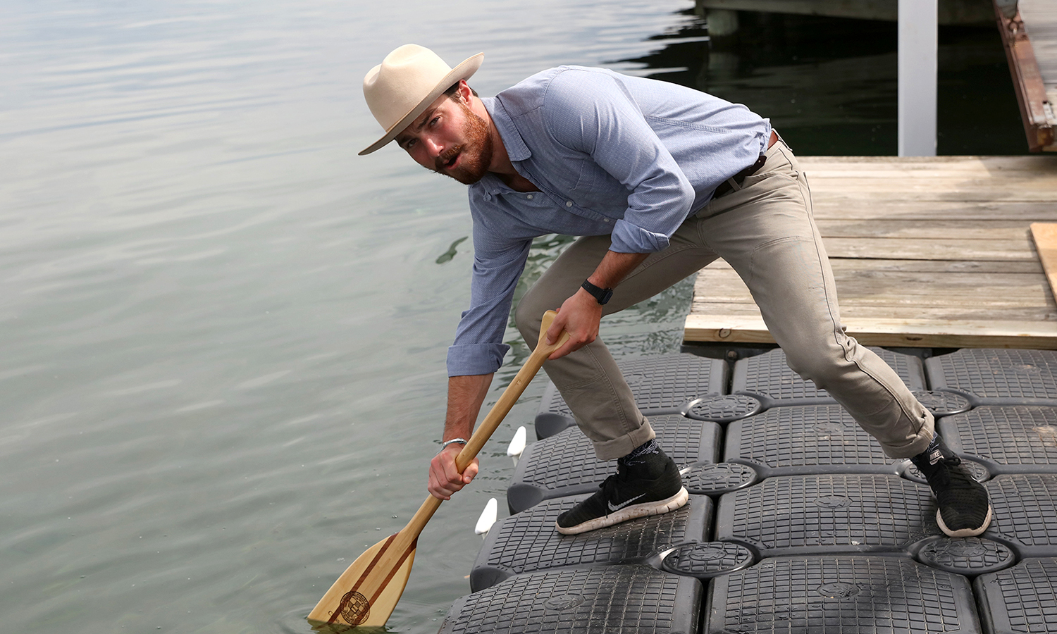 Riggs Alosa '17 dips his oar in Seneca Lake, a celebrated tradition of Hobart's heritage expressing the promise of a reciprocal lifelong bond between graduates and their alma mater.