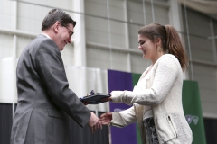 President Mark D. Gearan presents Carolyn Carr with the XXXX award during the Awards Ceremony in the Robert A. Bristol '31 Field House.