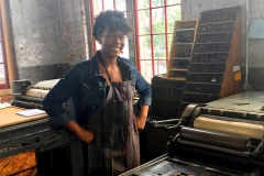 Tiara Sivells 'X stops for a photo during a letterpress workshop at The Cracker factory on Monday.