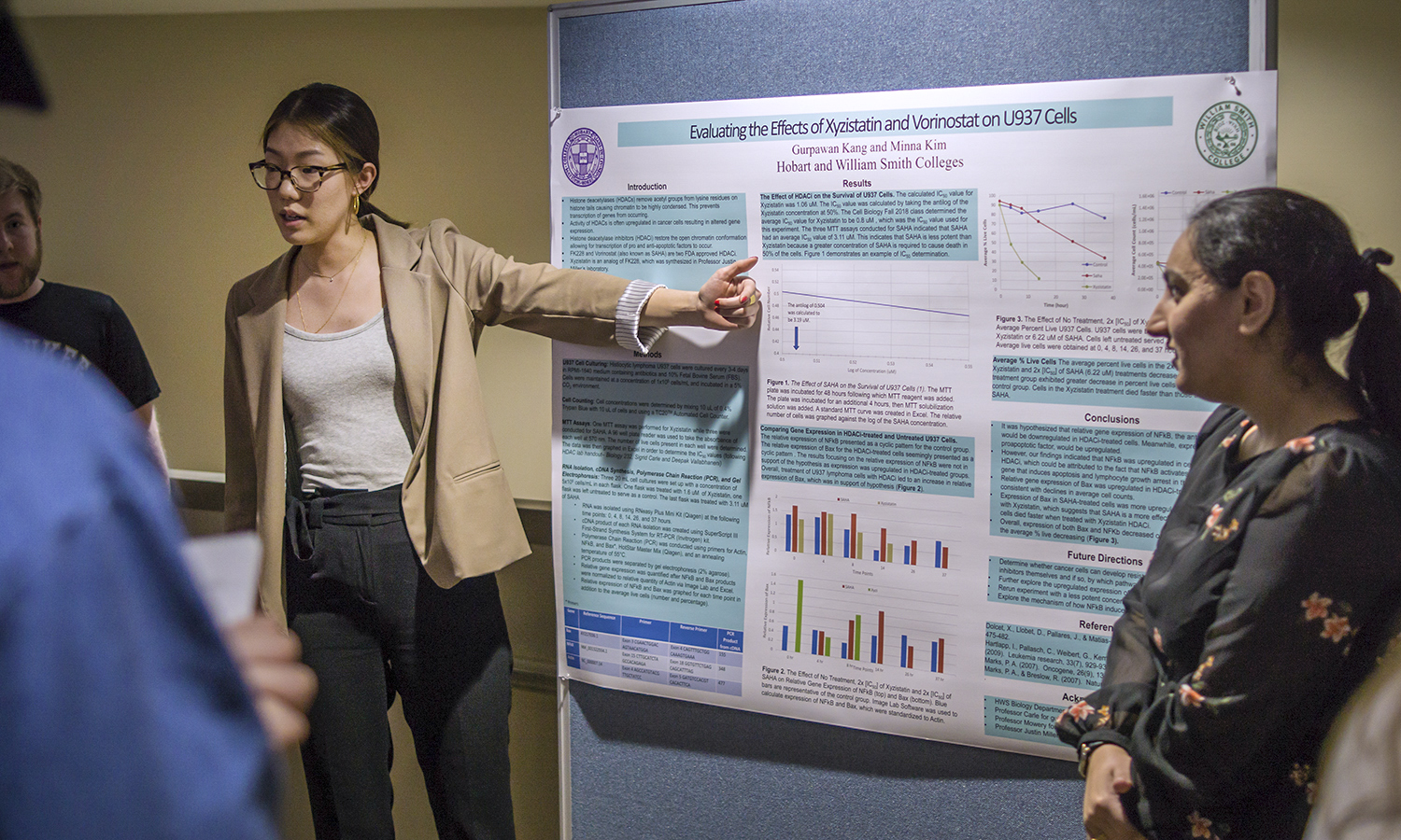 "Minna Kim '19 and Gurpawan Kang '19 present their project, ""Evaluating the Effects of Xyzistatin and Vorinostat on U937 Cells,"" during the Biology Student Research Symposium."