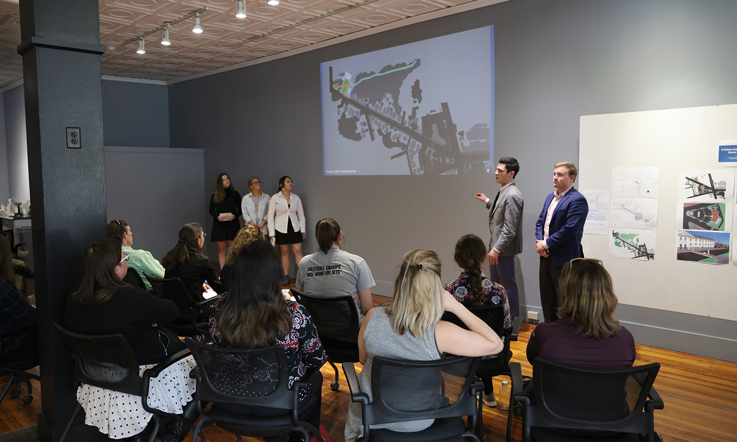 Students present a sustainability plan for the Castle Creek area ofGeneva as part of their Sustainable Community Development Capstone in the Bozzuto Center for Entrepreneurship.